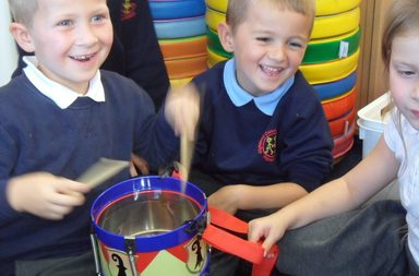 Year 2 enjoy playing with olden days toys
