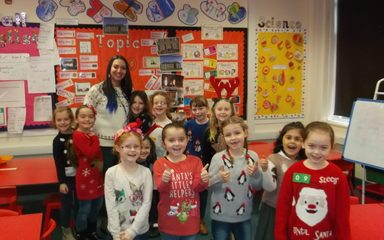 Merry Christmas from Year 2 in their Christmas jumpers