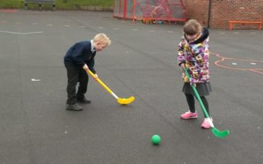 Year 2 practise their hockey skills