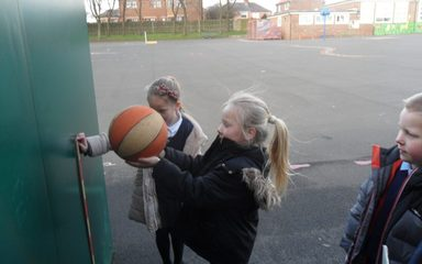 Year 2 science fun, finding out which balls bounce best.