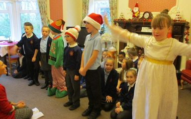 Y4 SJ Christmas Carol Singing at Hawksbury House