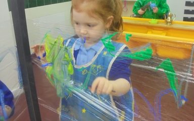 Cling film artists in Nursery